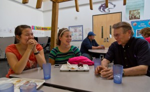 Nataly Meyer '13, McKenzie Allen '13 and Paul Berg '71 talk during dinner at the school in Akiachak, Alaska on Thursday, June 6, 2013. (Photo/John Froschauer)